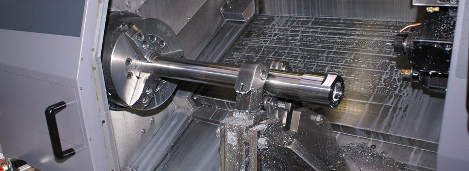 CNC drejning af aksler i brille.